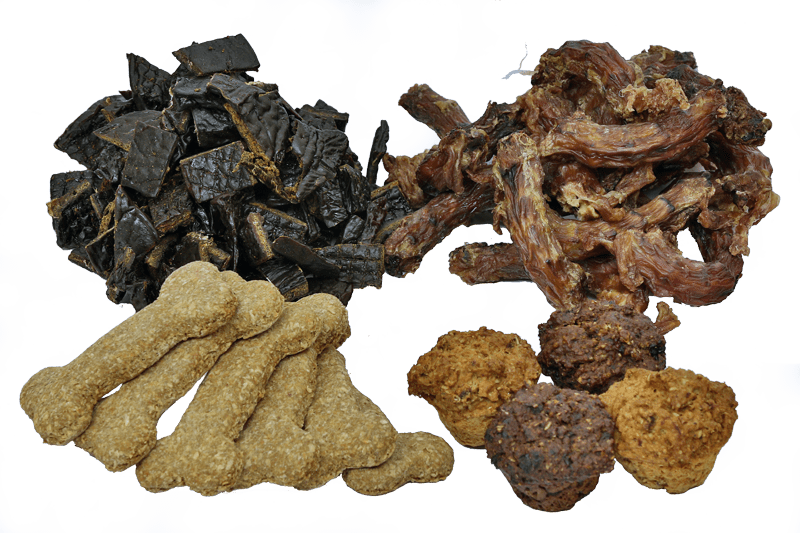 A selection of home-made dog treats,biscuits, dried liver and chicken necks and four meat muffins.